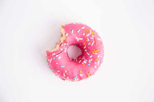 pink donut on white background
