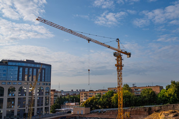 a yellow crane standing on construction site