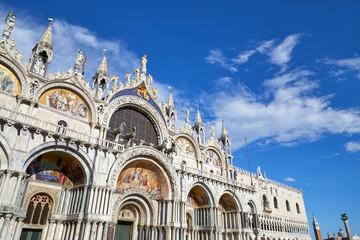 San Marco basilica facade in Venice, blue sky in a sunny day in Italy