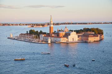 San Giorgio Maggiore island and basilica aerial view in a sunny summer evening in Venice, Italy
