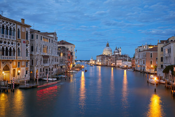 Grand Canal in Venice illuminated in the evening with Saint Mary of Health basilica view in Italy