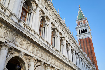 San Marco bell tower and National Marciana library facade, clear blue sky in Venice, Italy