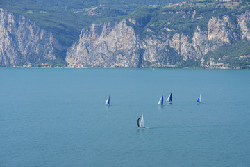 Sailboats on Lake Garda, one of the most popular Italian areas for water sports.