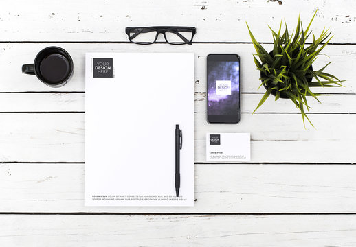 Letterhead, Business Card, and Smartphone on White Wood Desk Mockup