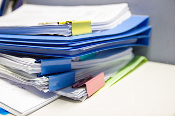 file folder and Stack of business report paper file on the table in a work office, concept document in work office