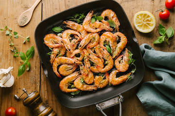 Roasted grilled shrimps on pan on wooden