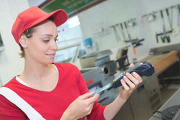 Lady in fast food outlet taking card payment