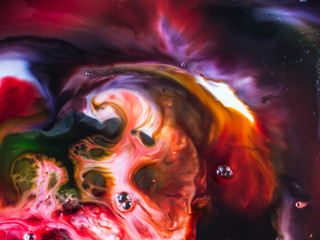 Abstract background, various pigments and dyes create a rich texture, blurred color background,