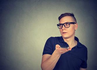 Irritated man using voice service