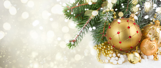 golden christmas decorations with evergreen tree close up on white background, winter banner