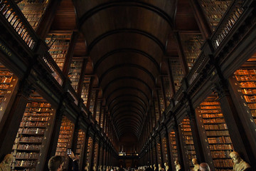 A tourist takes a picture on his mobile phone in the Long Room of the old library that houses 200,000 of Trinity College's oldest books in Dublin