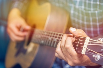 Close up of guitar player