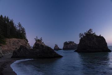 Sunset over Secret Beach Sea Stack Islands on the Oregon Coast near Brookings