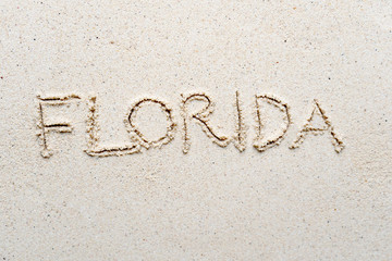 "Handwriting words ""Florida"" on sand"