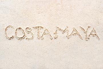 "Handwriting words ""Costa Maya"" on sand"