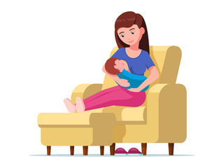 Young mother breastfeeding sitting on a chair