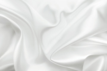 Elegant white satin silk with waves, abstract background.
