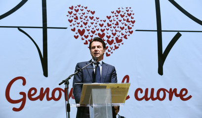 Italian Prime Minister Giuseppe Conte speaks during the day of commemoration to mark one month since Morandi bridge collapsed in Genoa