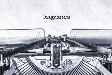 The word Diagnostics printed on a piece of paper on an old typewriter. information, writer.