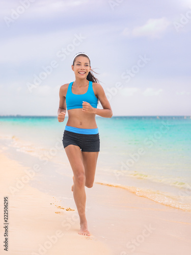 b7dcebfafc22 Active lifestyle young woman jogging on beach. Running barefoot on sand in  Hawaii vacation travel