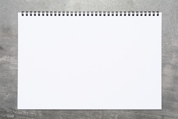Blank page of a sketchbook on a gray surface Wall mural