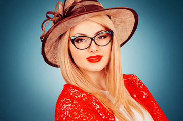 Beautiful young woman with glasses and hat, retro style