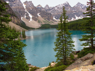 Blue glacier  water of Moraine Lake surrounded by mountains in the Valley of the Ten Peaks, Banff National Park, Alberta, Canada