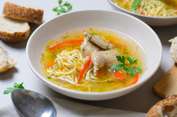 Quail Noodle Soup, Homemade Broth with Noodles and Vegetables Served with Bread Rolls, Zama, Traditional Moldavian and Romanian Soup