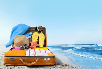 Retro suitcase with travel objects  on hotel background