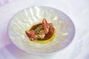 Fusion cuisine, fish with tomato