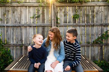 Siblings having fun together in garden