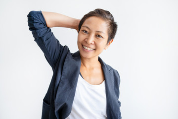 Relaxed Asian woman holding hand behind head and looking at camera. Young lady having break. Relaxed woman concept. Isolated front view on white background.