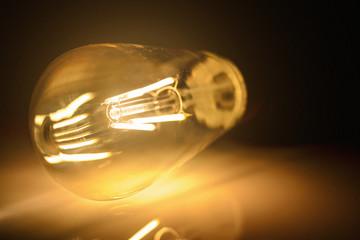Close-up photo of light bulb on dark background.