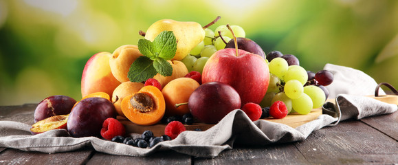 Zelfklevend Fotobehang Vruchten Fresh summer fruits with apple, grapes, berries, pear and apricot