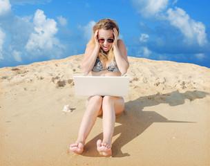 Fotobehang A girl sitting at work in a laptop receiving joyful shocking news