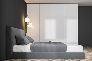 Gray bedroom interior, double bed side view