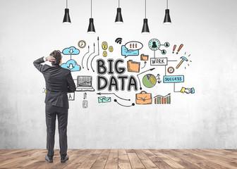 Young dark hair businessman looking at big data
