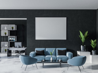 Black home office interior with sofa and poster