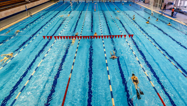 Indoor swimming pool in sport club. Swimming and aqua aerobics training. Healthy lifestyle concept.