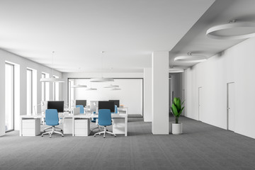 White open space office, blue chairs front view