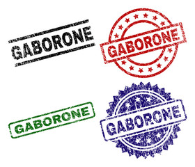GABORONE seal prints with corroded texture. Black, green,red,blue vector rubber prints of GABORONE caption with unclean texture. Rubber seals with round, rectangle, medallion shapes.