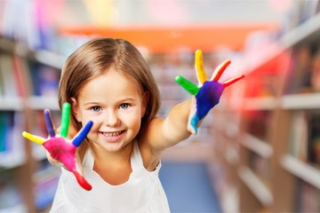 Little cute girl with hands in colored
