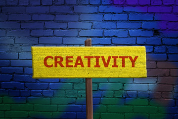 Creativity sign on artistic painted background