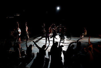 Members of Ziggurat Project perform during the Placcc Festival in the swimming pool of Csepeli Paper Factory in Budapest
