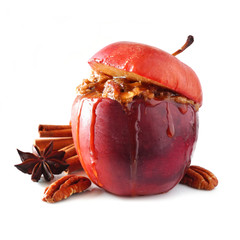 Baked apple with caramel, brown sugar, spices and and nuts isolated on a white background