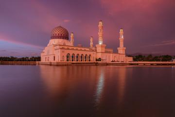 Kota Kinabalu Floating mosque with dramatics clouds during sunset , Beautiful sunset at Kota Kinabalu City Mosque Sabah Borneo, Malaysia