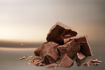 Dark chocolate blocks and bieces isolated on white background