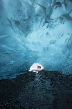 Hikers outside an Ice Cave in Juneau Alaska