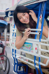 Portrait of thai china adult beautiful girl Green dress blue jeans relax and smile
