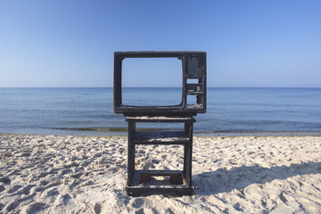 View on the sea thru old TV on the beach .